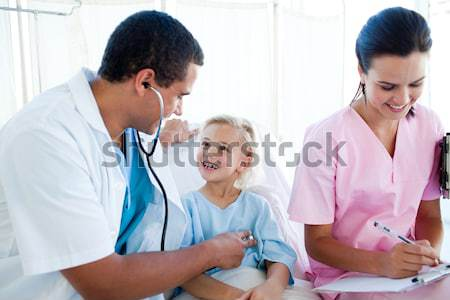 Child looking at his bandage in examination room Stock photo © wavebreak_media