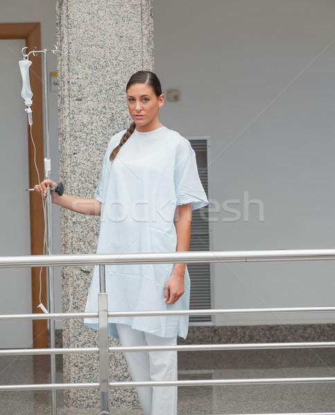 Stock photo: Patient walking in the corridor in hospital