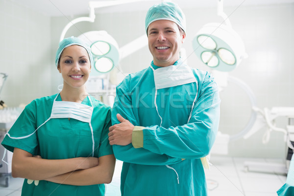 Surgeons looking at camera in an operating theatre Stock photo © wavebreak_media