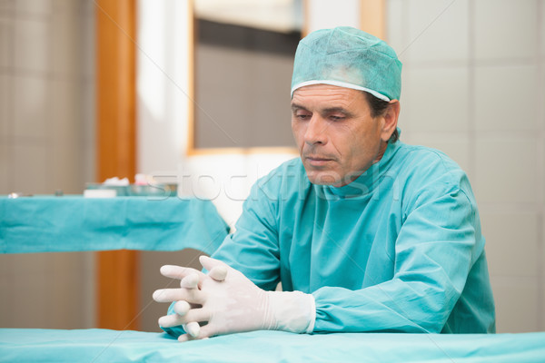 Thoughtful surgeon sitting in a operating room in a hospital Stock photo © wavebreak_media