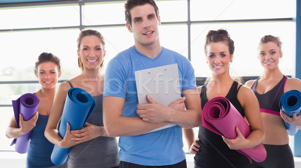 Yoga class with their trainer in gym Stock photo © wavebreak_media