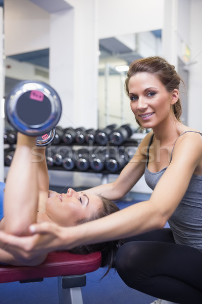 Trainer smiling with woman lifting weights Stock photo © wavebreak_media