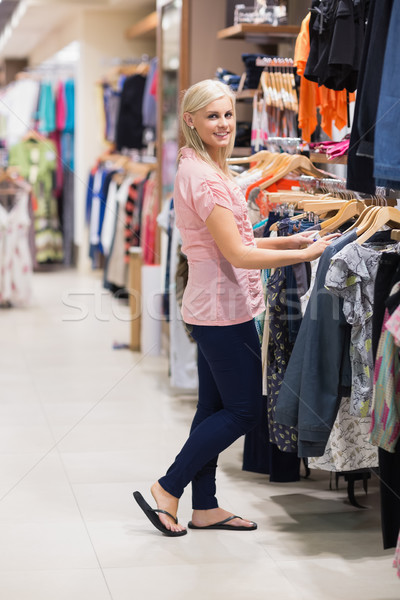 Woman is searching for clothes smiling  Stock photo © wavebreak_media