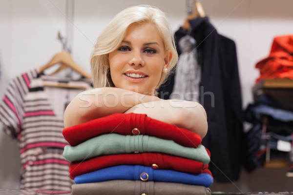 Woman leaning on clothes at a boutique smiling  Stock photo © wavebreak_media