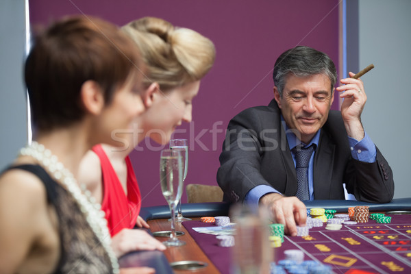 Man with cigar placing bet at roulette Stock photo © wavebreak_media