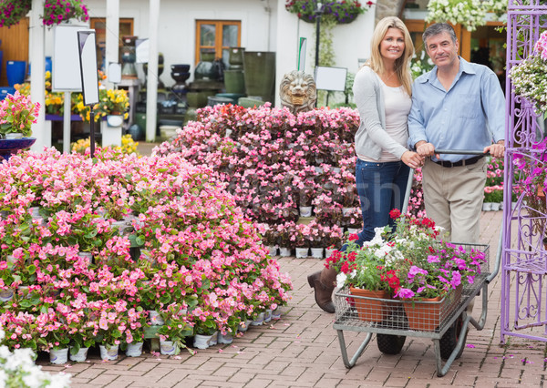 Couple pushing a trolley in garden centre while smiling Stock photo © wavebreak_media
