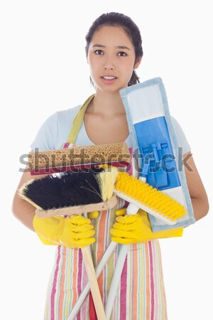 Smiling woman standing with crossed arms and wearing apron and rubber gloves Stock photo © wavebreak_media