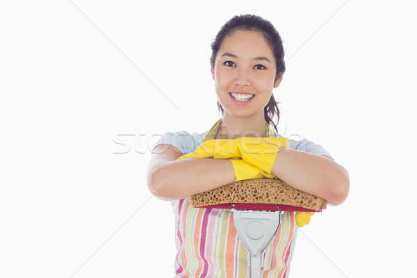 Happy woman wearing gloves and apron leaning on mop Stock photo © wavebreak_media