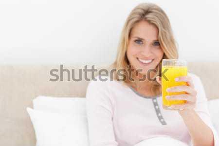 Gelukkig vrouw sap oranje portret Stockfoto © wavebreak_media
