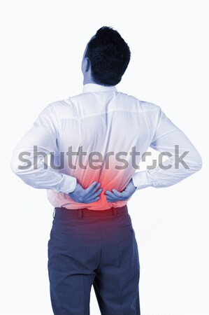 Rear view of business man with back pain Stock photo © wavebreak_media