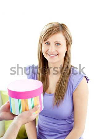 Smiling woman holding soap suds over sponge  Stock photo © wavebreak_media
