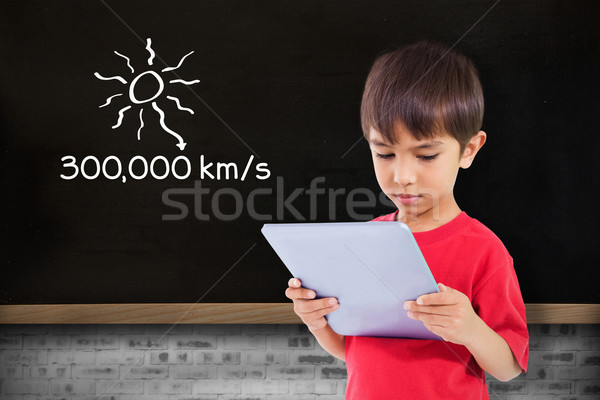 Composite image of cute boy using tablet Stock photo © wavebreak_media
