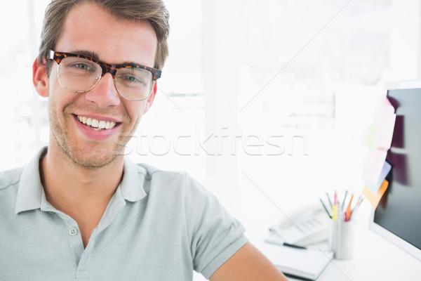 Portrait of a casual male photo editor smiling Stock photo © wavebreak_media