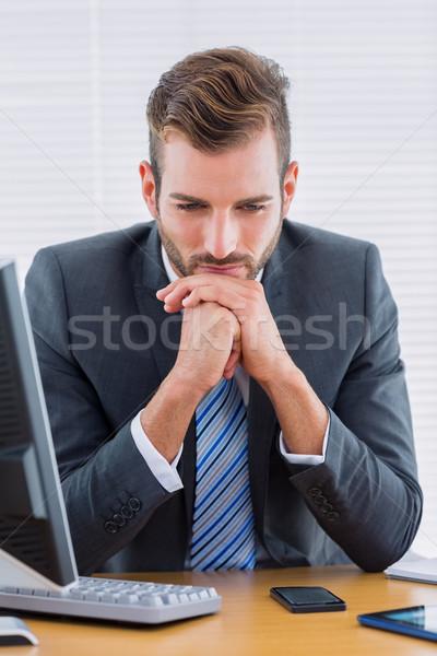 Thoughtful businessman sitting at office desk Stock photo © wavebreak_media