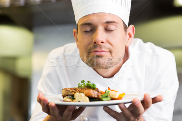 Closeup of a chef with eyes closed smelling food Stock photo © wavebreak_media