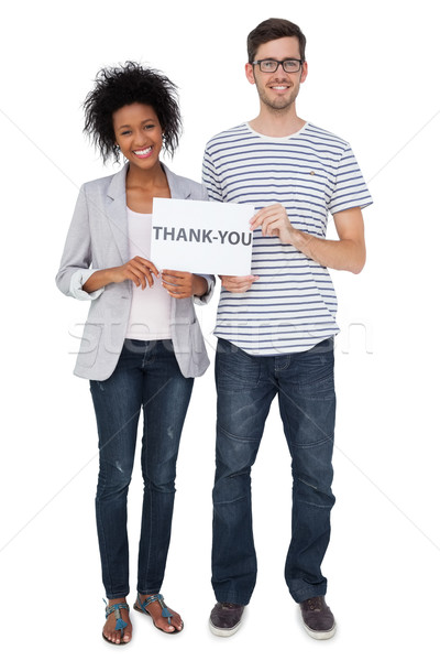 Portrait of a smiling couple holding a thank you note Stock photo © wavebreak_media