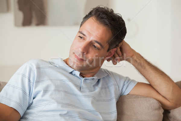 Close-up of a thoughtful man sitting on sofa Stock photo © wavebreak_media