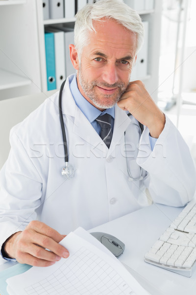 Mature male doctor at desk in the medical office Stock photo © wavebreak_media