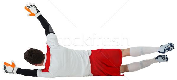Goalkeeper in white making a save Stock photo © wavebreak_media