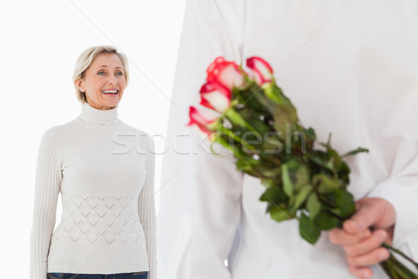 Man hiding bouquet of roses from older woman Stock photo © wavebreak_media