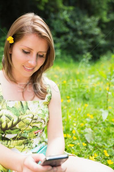 женщину области цветы Сток-фото © wavebreak_media