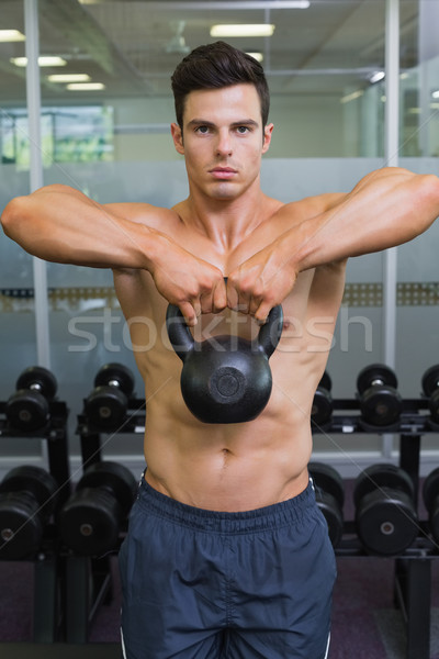 Muscular man lifting kettle bell in gym Stock photo © wavebreak_media