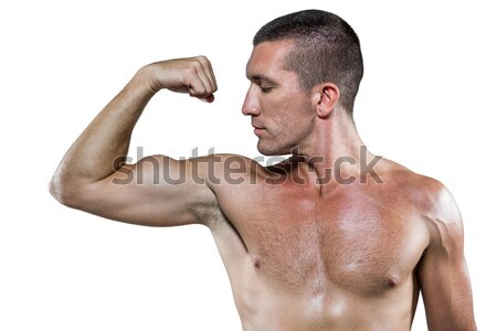 Muscular man posing with nutritional supplement in gym Stock photo © wavebreak_media