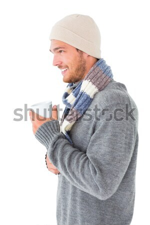 Handsome man in winter fashion holding mug Stock photo © wavebreak_media
