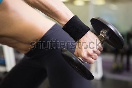 Mid section of fit woman exercising with dumbbell in gym Stock photo © wavebreak_media