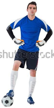 Sportos futballista éljenez fehér futball kék Stock fotó © wavebreak_media
