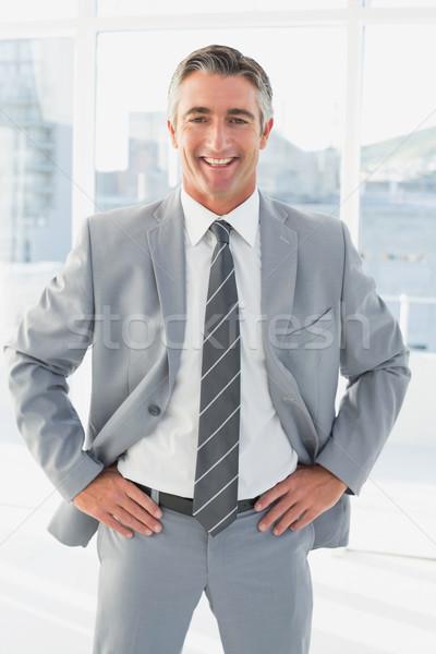 Empresário olhando câmera mãos quadris negócio Foto stock © wavebreak_media