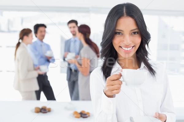Lächelnd Geschäftsfrau trinken Arbeit Essen Mann Stock foto © wavebreak_media