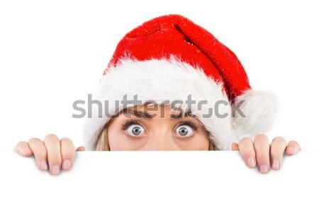 Festive redhead smiling at camera holding poster Stock photo © wavebreak_media