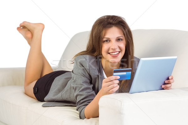Woman doing online shopping with tablet and credit card Stock photo © wavebreak_media