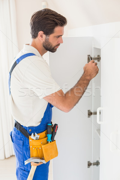 Handyman fixing a wardrobe Stock photo © wavebreak_media