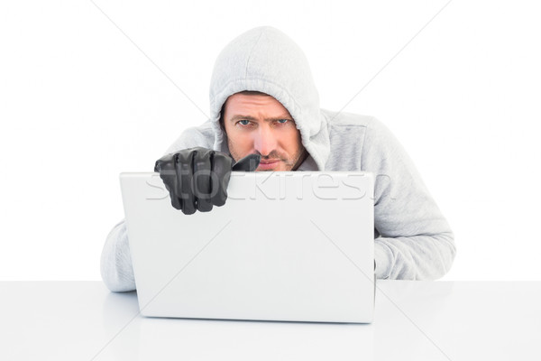 Stock photo: Hacker using laptop to steal identity
