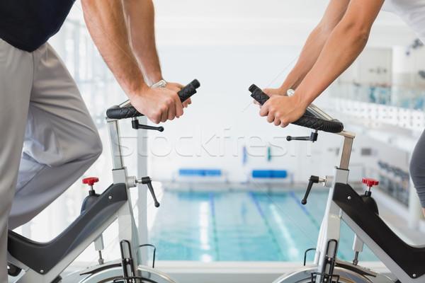 Középső rész pár dolgozik testmozgás biciklik tornaterem Stock fotó © wavebreak_media