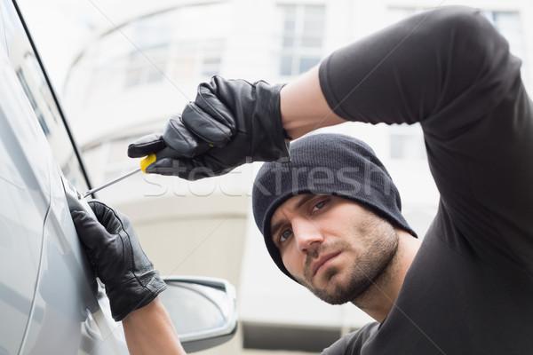 Tolvaj autó csavarhúzó kalap férfi biztosítás Stock fotó © wavebreak_media