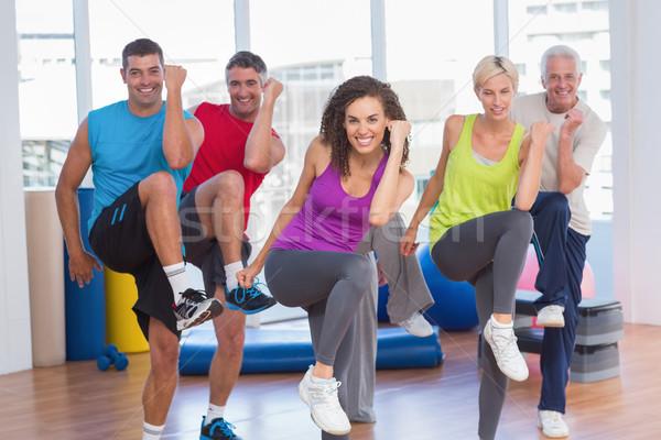 Emberek előad aerobik testmozgás tornaterem osztály Stock fotó © wavebreak_media