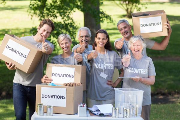Boldog önkéntes család remek napos idő kezek Stock fotó © wavebreak_media