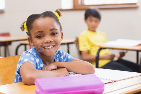 Smiling pupil sitting at her desk  Stock photo © wavebreak_media