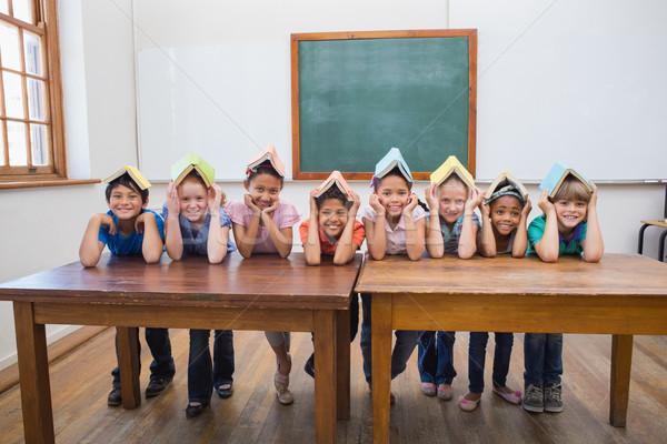 Aranyos iskolás mosolyog osztályterem általános iskola könyvek Stock fotó © wavebreak_media
