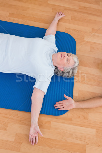 Senior woman lying on exercise mat  Stock photo © wavebreak_media
