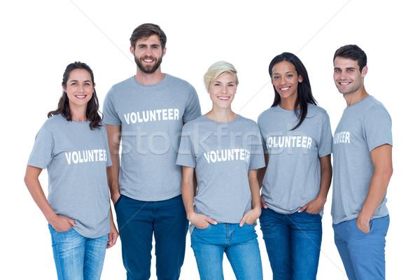 Volontari amici sorridere fotocamera felice mani Foto d'archivio © wavebreak_media