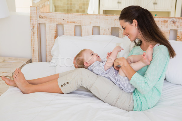 Happy mother with her baby boy Stock photo © wavebreak_media