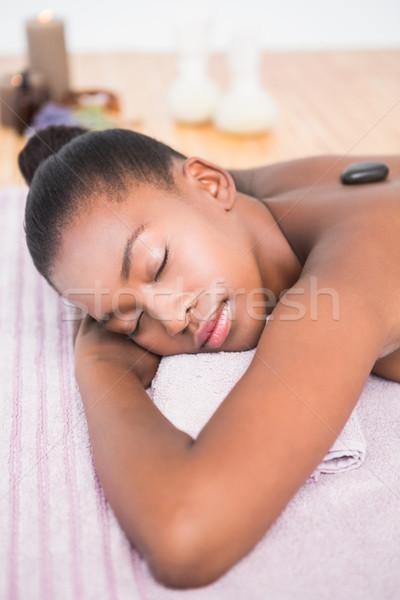 Pretty woman caldo pietra massaggio Foto d'archivio © wavebreak_media
