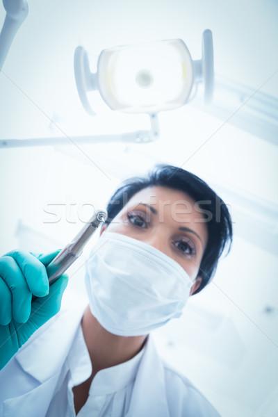 Homme dentiste masque chirurgical dentaires forage Photo stock © wavebreak_media