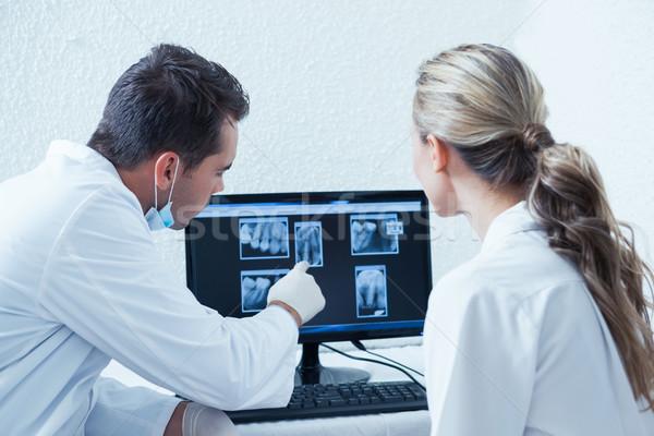 Dentists looking at x-ray on computer Stock photo © wavebreak_media
