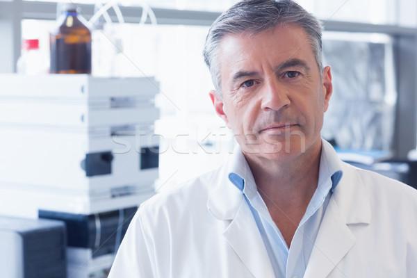 Portrait of an unsmiling scientist wearing lab coat Stock photo © wavebreak_media