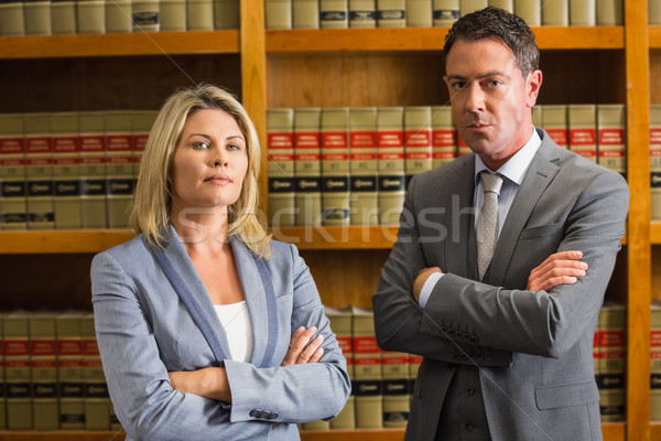 Lawyers looking at camera in the law library Stock photo © wavebreak_media